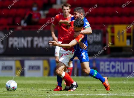 Albie Morgan of Charlton Athletic is held by the neck by Sam Sayed Morsy of Wigan Athletic