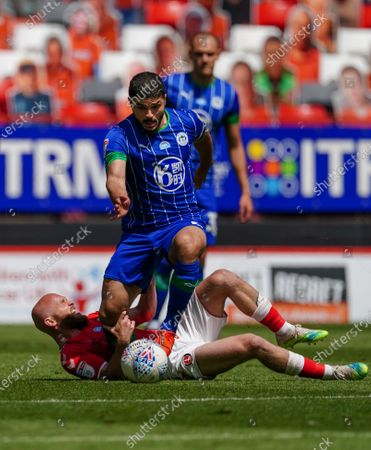 Sam Sayed Morsy of Wigan Athletic runs over Jonathan Williams of Charlton Athletic