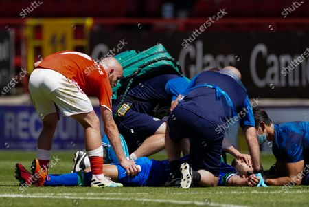 Jonathan Williams of Charlton Athletic pats Sam Sayed Morsy of Wigan Athletic on the leg as Sam Sayed Morsy receives medical treatment on the pitch