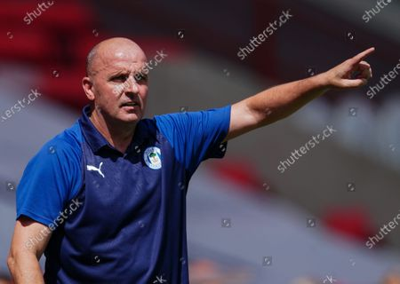 Paul Cook Wigan Athletic Manager signals from the sideline