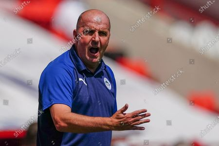 Paul Cook Wigan Athletic Manager reacts on the sideline