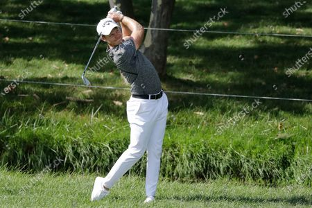 Danny Willet hits from the 18th fairway during the second round of the Memorial golf tournament, in Dublin, Ohio