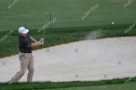 Ernie Els, of South Africa, hits from a bunker toward the 13th green during the second round of the Memorial golf tournament, in Dublin, Ohio