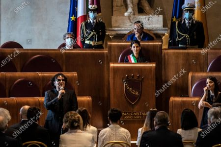 Singer Renato Zero during his speech, Mayor of Rome Virginia Raggi at the etraordinary assembly for the Maestro Ennio Morricone