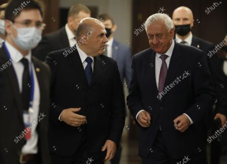 Russian Prime Minister Mikhail Mishustin (front C)  talks to Chairman of the Eurasian Economic Comission Board, Mikhail Myasnikovich (front R) before an expanded meeting of the Eurasian Intergovernmental Council in Minsk, Belarus, 17 July 2020.