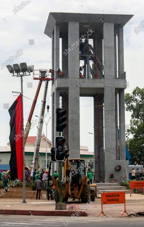 Workers ready a new monument, called the Peace Bell, before its inauguration ceremony later in the day in Managua, Nicaragua, . Nicaraguan President Daniel Ortega's government is being deterred by the new coronavirus from holding the usual mass celebration to mark the victory of the country's revolution July 19, and will instead unveil a new addition to its collection of monuments