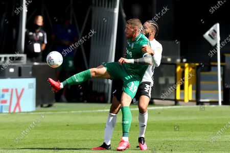 Stock Photo of Craven Cottage, London, England; Connor Wickham of Sheffield Wednesday competes for the ball with Michael Hector of Fulham; English Championship Football, Fulham versus Sheffield Wednesday.