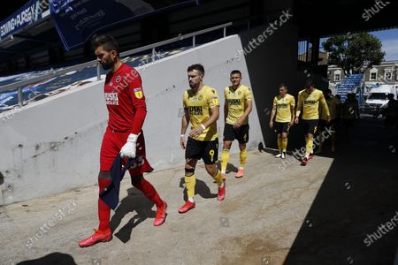 The Kiyan Prince Foundation Stadium, London, England; Goalkeeper Jesse Debrah, Tom Bradshaw, Shaun Hutchinson, Jed Wallace and Ben Thompson of Millwall walking from the away tunnel onto the pitch before kick off; English Championship Football, Queen Park Rangers versus Millwall.