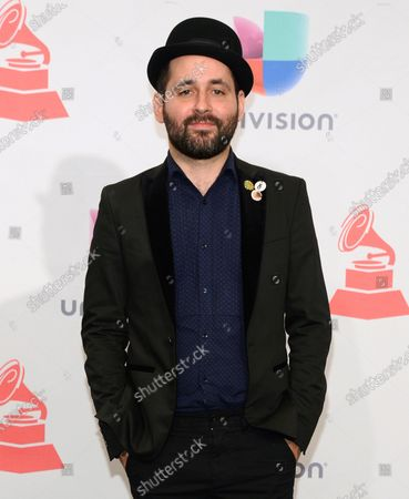 """Eduardo Cabra, of Calle 13, poses in the press room at the 16th annual Latin Grammy Awards in Las Vegas. Cabra killed off his """"Visitante"""" persona in the graphic new video """"La Cabra Jala Pal Monte,"""" stepping into the forefront for the first time as CABRA with his newly formed record label, La Casa del Sombrero"""