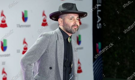 """Eduardo Cabra, of Calle 13, arrives at the Latin Grammy Awards in Las Vegas. Cabra killed off his """"Visitante"""" persona in the graphic new video """"La Cabra Jala Pal Monte,"""" stepping into the forefront for the first time as CABRA with his newly formed record label, La Casa del Sombrero"""