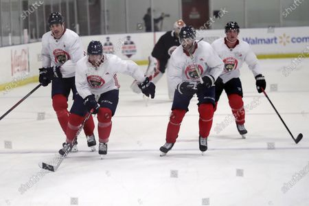 Florida Panthers' Brian Boyle, left, Keith Yandle (3), Brett Connolly (10) and Noel Acciari, right, skate during NHL hockey practice, in Coral Springs, Fla