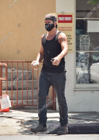 Colin Farrell is seen on a coffee run