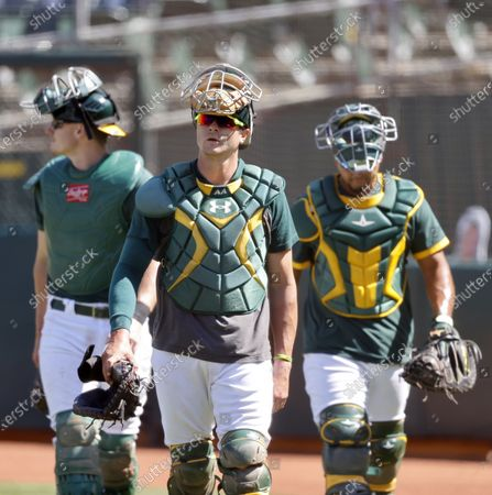 Stock Image of Oakland Athletics catchers Austin Allen (C), Sean Murphy (L) and Carlos Perez (R) during summer camp before the restart of the 2020 MLB season at the Oakland Coliseum in Oakland, California, USA, 17 July 2020. The start of the season was delayed due to the coronavirus pandemic.