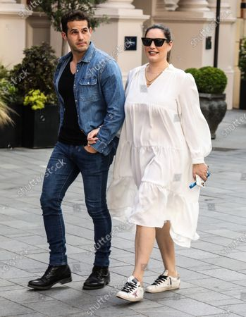 Kelly Brook and Jeremy Parisi arrive at the Global Radio Studios