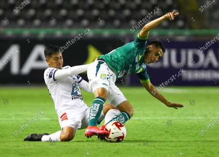 David Ramirez (R) ofLeon in action against Erick Daniel Sanchez (L) of Pachuca during the Copa Telcel game prior to the start of the Apertura 2020 tournament of the Mexican soccer league in Leon, Guanajuato, Mexico, 17 July 2020.