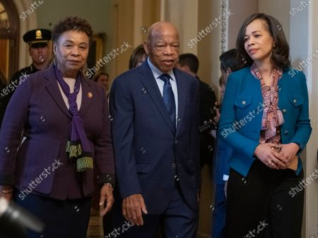 Stock Photo of United States Representatives Barbara Lee (Democrat of California), left, John Lewis (Democrat of Georgia), center, and Lisa Blunt Rochester (Democrat of Delaware), right, depart the US Senate Chamber after joining their US House Democratic colleagues in witnessing two votes on legislation to reopen the government in the US Capitol in Washington, DC. Both proposals were voted upon and both failed to get enough votes to pass.