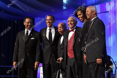 From left to right: Congressional Black Caucus (CBC) Chairman, United States Representative Emanuel Cleaver II (Democrat of Missouri); U.S. President Barack Obama; U.S. Representative John Lewis (Democrat of Georgia); Reverend Joseph Lowery; First Lady Michelle Obama; CBC Foundation Chairman U.S. Representative Donald Payne (Democrat of New Jersey) stand for a photo at the conclusion of the Congressional Black Caucus Foundation Annual Phoenix Awards dinner in Washington, DC, September 24, 2011. .
