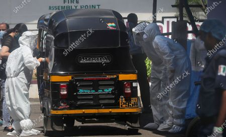 Stock Picture of Health workers question passengers in an autorickshaw before allowing them to enter Nanavati hospital, where Bollywood legend Amitabh Bachchan, his son Abhishek Bachchan, daughter-in-law Aishwarya Rai Bachchan and granddaughter are being treated for COVID-19, in Mumbai, India