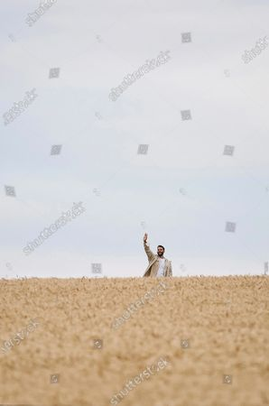 Stock Photo of Designer Simon Porte Jacquemus waves to spectators during the fashion show of French fashion house Jacquemus at a wheat field in Vexin, near Paris, France, July 16, 2020.