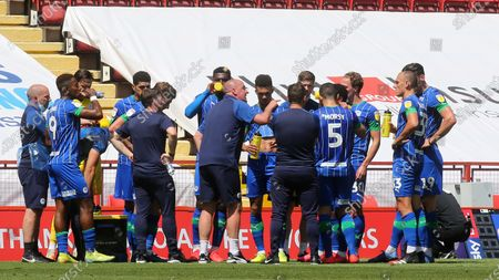 Wigan Manager, Paul Cook, chats to his players in the drinks break during Charlton Athletic vs Wigan Athletic, Sky Bet EFL Championship Football at The Valley on 18th July 2020