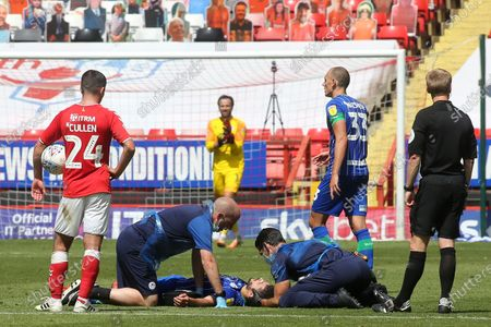 Wigan's Sam Morsy receives some treatment after suffering an injury in the second half during Charlton Athletic vs Wigan Athletic, Sky Bet EFL Championship Football at The Valley on 18th July 2020