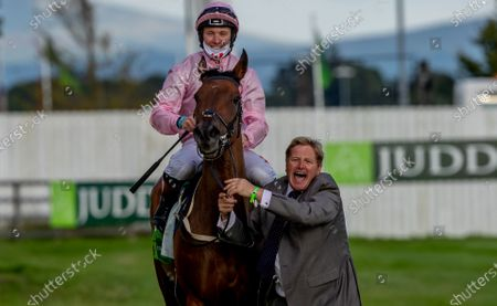 Stock Photo of Assistant trainer Shane Lyons celebrates with jockey Colin Keane after winning The Juddmonte Irish Oaks with Even So