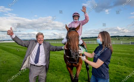 Stock Picture of Assistant trainer Shane Lyons celebrates with jockey Colin Keane after winning The Juddmonte Irish Oaks with Even So