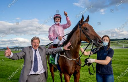 Assistant trainer Shane Lyons celebrates with jockey Colin Keane after winning The Juddmonte Irish Oaks with Even So