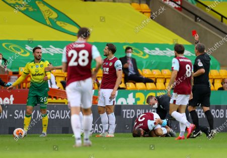 Referee Kevin Friend shows a red card to Norwich City's Josip Drmic, left, during the English Premier League soccer match between Norwich City and Burnley at Carrow Road Stadium in Norwich, England