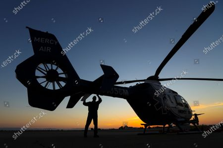 Stock Image of Pilot Michael Bobeck at the start of his 12 hours night shift checks Mercy Air air ambulance helicopter based at Imperial County Airport, Imperial. Imperial County Airport on Sunday, July 12, 2020 in Imperial, CA. (Irfan Khan/Los Angeles Times)