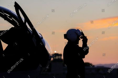 Pilot Michael Bobeck at the start of his 12 hours night shift adjusts night vision goggles at Mercy Air air ambulance base at Imperial County Airport, Imperial. Imperial County Airport on Sunday, July 12, 2020 in Imperial, CA. (Irfan Khan/Los Angeles Times)
