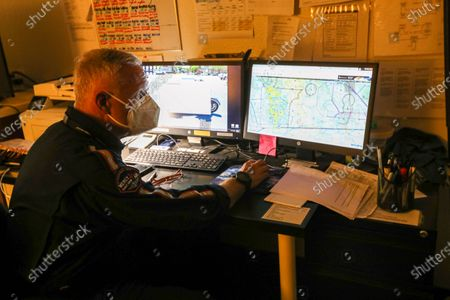 Pilot Michael Bobeck at the start of his 12 hours night shift checks flight map and weather condition for night flights at Mercy Air air ambulance base at Imperial County Airport, Imperial. Imperial County Airport on Sunday, July 12, 2020 in Imperial, CA. (Irfan Khan/Los Angeles Times)
