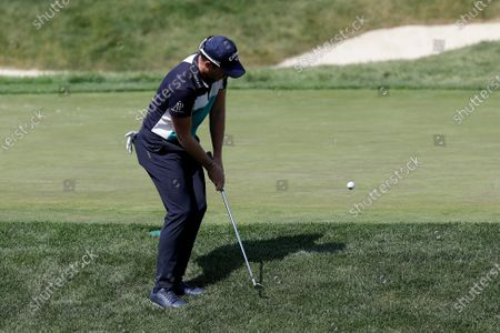 Danny Willet chips in for birdie on the 14th hole during the third round of the Memorial golf tournament, in Dublin, Ohio