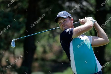 Danny Willet hits from the second tee during the third round of the Memorial golf tournament, in Dublin, Ohio