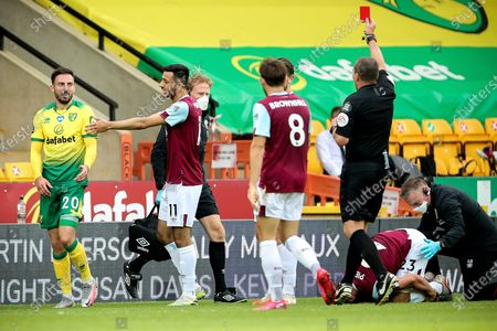 Stock Picture of Norwich's Josip Drmic (L) is booked red card by referee Kevin Friend (R) during the English Premier League soccer match between Norwich City and Burnley FC in Norwich, Britain, 18 July 2020.