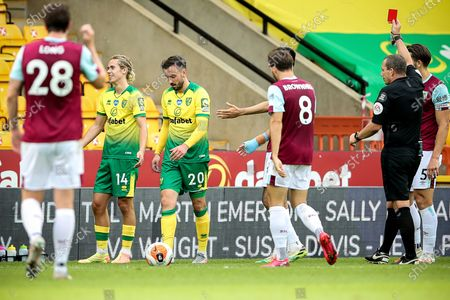 Norwich's Josip Drmic (3-L) leaves the pitch after booking red card and being sent off by referee Kevin Friend (R) during the English Premier League soccer match between Norwich City and Burnley FC in Norwich, Britain, 18 July 2020.