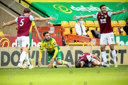 Norwich's Josip Drmic (2-L) in action against Burnley's Erik Pieters (2-R) during the English Premier League soccer match between Norwich City and Burnley FC in Norwich, Britain, 18 July 2020.