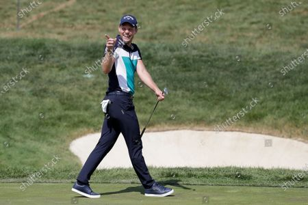 Danny Willet smiles after chipping in for birdie on the 14th hole during the third round of the Memorial golf tournament, in Dublin, Ohio