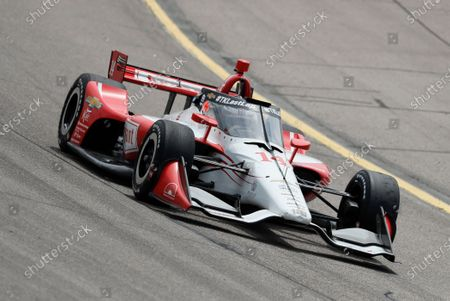 Tony Kanaan, of Brazil, drives his car during practice for an IndyCar Series auto race, at Iowa Speedway in Newton, Iowa