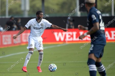 Philadelphia Union defender Raymon Gaddis (28) sets up a play in front of New York City FC defender Ronald Matarrita (22) during an MLS soccer match, in Kissimmee, Fla