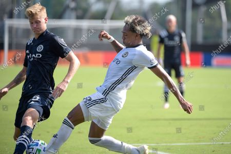 New York City FC midfielder Keaton Parks (55) and Philadelphia Union midfielder Jose Andres Martinez (8) compete for a ball during an MLS soccer match, in Kissimmee, Fla