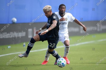 New York City FC defender Ronald Matarrita (22) and Philadelphia Union midfielder Anthony Fontana (21) compete for a ball during an MLS soccer match, in Kissimmee, Fla