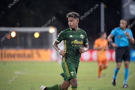 Portland Timbers forward Andy Polo sets up for a shot during the second half of an MLS soccer match against the Houston Dynamo, in Kissimmee, Fla