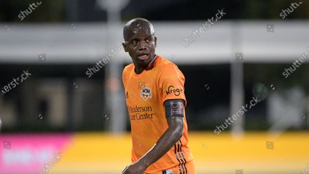 Stock Photo of Houston Dynamo midfielder Oscar Garcia (27) follows a play during the first half of an MLS soccer match against the Portland Timbers, in Kissimmee, Fla