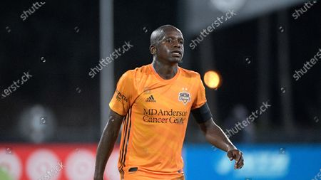 Stock Image of Houston Dynamo midfielder Oscar Garcia follows a play during the second half of an MLS soccer match against the Portland Timbers, in Kissimmee, Fla