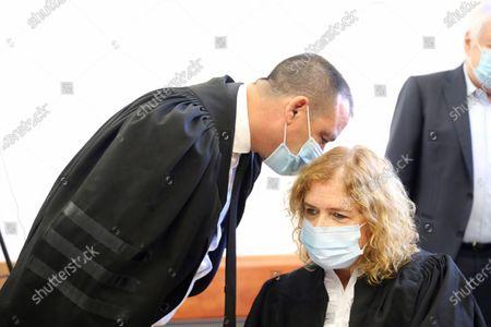 Liat Ben Ari, right, plaintiff in the trial against Prime Minister Benjamin Netanyahu is seen in the district court in Jerusalem