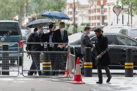 Liu Xiaoming, Chinese ambassador to the UK (C), arrives at the BBC Broadcasting House in central London