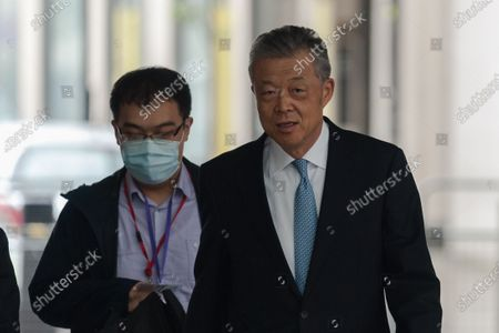 Stock Photo of Liu Xiaoming, Chinese ambassador to the UK (R), arrives at the BBC Broadcasting House in central London