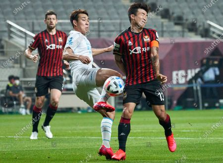 Stock Image of Song Min-kyu of Pohang Steelers competes for the ball with Go Yo-han of FC Seoul during 2020 K League 1 match between Pohang Steelers and FC Seoul at the seoul world cup stadium.