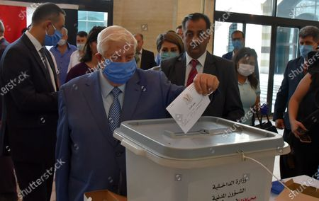 Syrian Foreign Minister Walid al-Moallem casts his vote in the People's Assembly (parliament) elections in a polling station in Damascus, Syria, 19 July 2020. According to reports, 250 Syrian MPs will be elected by direct vote for a four-year term. A total of 1656 candidates are participating in this election process, including 200 women.